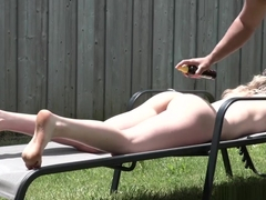 Nude sunbathing blonde fucked in the backyard