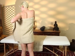Busty babe screwed from behind by masseur