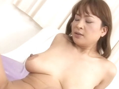 Cute Japanese with hot boobs masturbates wildly with toys