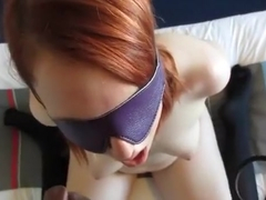 My redhead gf sucks off a black bull blindfolded and handcuffed
