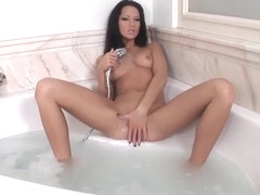 Brunette stripping and teasing in bath