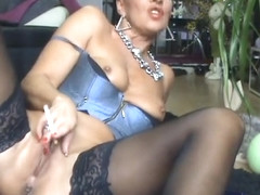pierced mature slut smoking and pissing tease
