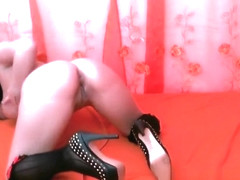 Spreading her legs and playing with her pussy
