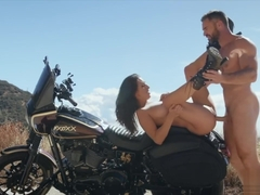 Pumping cock into Ashley Adams outdoors on a motorbike
