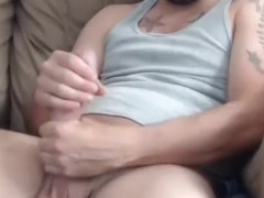 Fascinating fag is jerking off within doors and shooting himself on camera