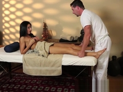 Smalltits babe pussyfucked on massage table