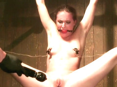 Gagged slave in strait jacket tormented