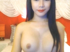 Busty Shemale plays with Tranny Cock
