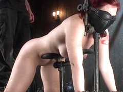Redhead blindfolded in device bondage
