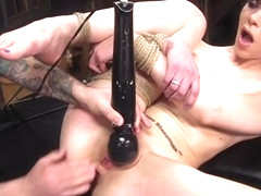 Brunette slave gets fisting training