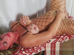 Hot Chick In Fishnet Stockings Finger Blasts Her Cunt