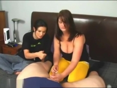 Two girls stroking a tiny dick
