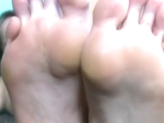 Canadian babe shows off feet and sucks her toes