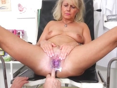 Blonde granny, Koko takes off her clothes in her doctors office and asks for some pleasure