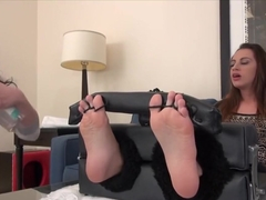 Oiled feet tickled