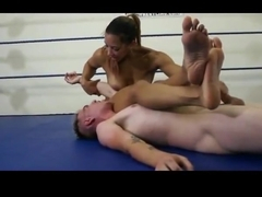 muscle girl fights guy in the ring and handjobs him