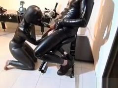 Horny Slut Gets In Latex Suit To Suck