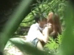 Redhead girl sucks guy dick in the woods, and then fucks him