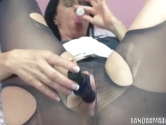 Busty MILF Melissa Swallows masturbates with two dildos