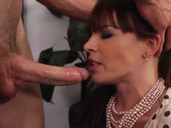 Hot brunette prostitute Dana DeArmond sucks a gigantic cock