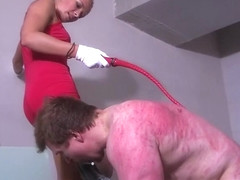 Hot young blonde angry mistress in red dress punishes slave