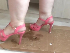 Big legs in open shoes crush and trample the box with high heels to cod.