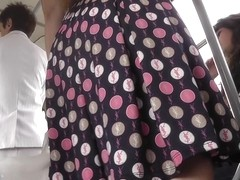 Hotty in polka dot suit up petticoat on bus