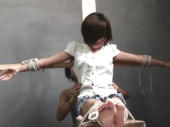 Chinese girl tied foot tickling 1