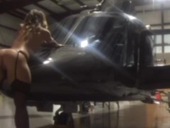 18Yr old does a striptease in a helicopter with heels and stockings