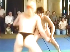 Topless Housewives mat wrestling