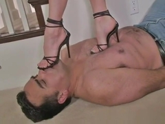 Mistress trampling on slave with high heels