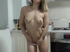 muscle girl striptease in the kitchen