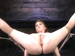 Natural busty redhead suffers hogtie