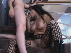 Fishnet milf fucked on stairs