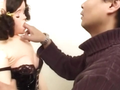 Dude tying up sex doll in BDSM position