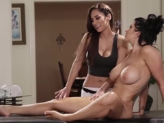 Busty Romi Rain enjoys licking Masseuse Reena Skys wet pussy in the table