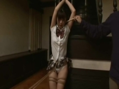 School Girl tied and being tease by brush