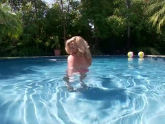 Blonde babe Ainsley Addison in the pool in a solo masturbation session