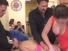 Blue haired slave sucks in public