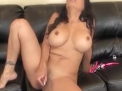 Big Tit Hottie Alexis Amore Sits On The Couch Posing And Toying Her Twat