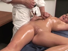 Sexy blonde is oiled all over her hot body