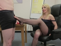 Classy CFNM babe jerking cock at the office