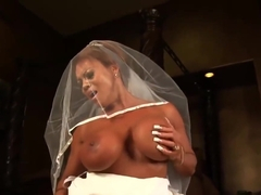 Big sexy bodybuilder rides the Sybian fast and hard in her wedding dress