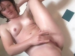 Lady With Big Ass Soaps Up And Showers Before Fingering Her Pussy