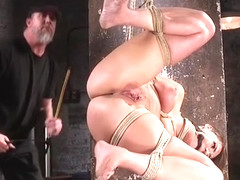 Busty slave tied up and crotch roped