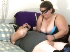 Chubby Sissy in leather pants cuffed & jerked off by bbw mistress, eats cum