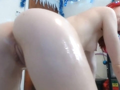 PALE SKINNED REDHEADED CUTIE OILS UP ON WEBCAM