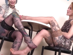 Two Tattooed Lesbians In Stockings Play Hot Footsies - Denise Connors And Stella Banxxx