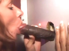 Redheaded Amateur Sucking Black Dick Through A Glory Hole