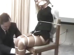 Amber Michaels chair tied